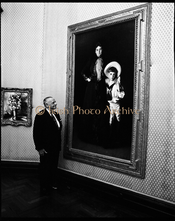Armand Hammar Collection, Exhibition.<br /> 1972.<br /> 09.08.1972.<br /> 08.09.1972.<br /> 9th August 1972.<br /> Dr Armand Hammer arrived at the National Art Gallery in Dublin to open an exhibition of his art collection. The exhibition will be open to the public until October the 1st.<br /> <br /> Image of Dr Armand Hammar posing with the portraits of Mrs Edward L Davis and her son Livingstone. The painting by world famous artist John Singer Sargent (1856 - 1925) is part of the collection loaned to the gallery by Dr Hammar.
