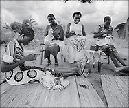 Womens needlework  cooperative  at work under the shade of a tree - West  Nile, Moyo District, Uganda.