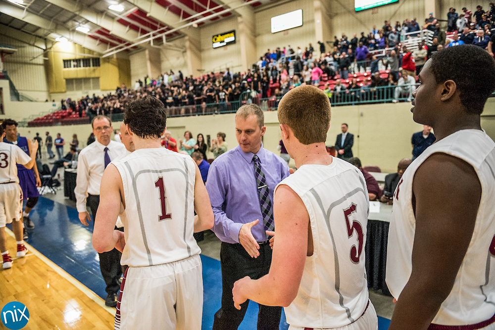 Cox Mill head coach Jody Barbee shakes hands with Jay M. Robinson players after the NCHSAA 3A regional semi-finals at the Cabarrus Arena & Event Center in Concord Tuesday night. Robinson won the game 80-69 to advance to the regional finals.