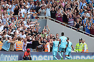 West Ham United fans celebrate as Mauro Zarate of West Ham United (10) celebrates scoring his sides second goal of the game to make it 0-2. Barclays Premier League, Arsenal v West Ham Utd at the Emirates Stadium in London on Sunday 9th August 2015.<br /> pic by John Patrick Fletcher, Andrew Orchard sports photography.