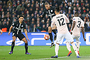 Kylian Mbappe of Paris Saint-Germain battles in front of goal with Manchester United Defender Eric Bailly and Manchester United Defender Chris Smalling during the Champions League Round of 16 2nd leg match between Paris Saint-Germain and Manchester United at Parc des Princes, Paris, France on 6 March 2019.