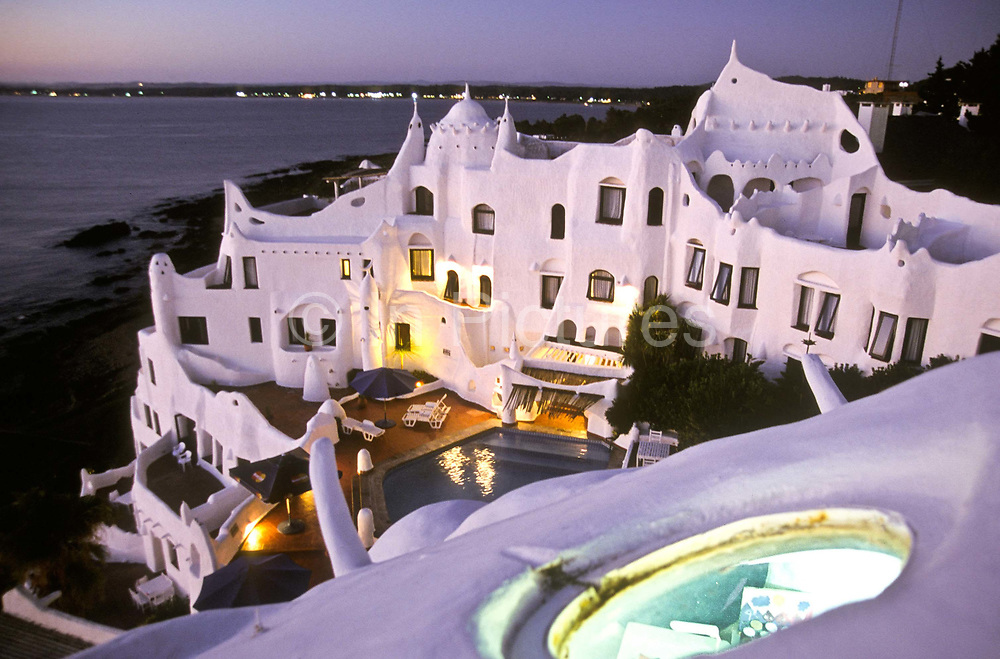 """""""Casapueblo"""" the home, studio and hotel of artist Carlos Paez Villaró. The building was designed and built by the artist, whose eccentric personality he is famed for, Punta del Este, Uruguay"""