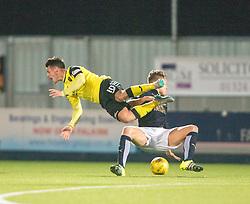 Livingston Danny Mullen tackled by Falkirk's Peter Grant. Falkirk 2 v 0 Livingston, Scottish Championship game played 29/12/2015 at The Falkirk Stadium.