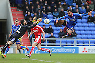 Aaron Amadi-Holloway of Oldham Athletic puts Tommy Lee of Chesterfield under pressure during the Sky Bet League 1 match between Oldham Athletic and Chesterfield at Boundary Park, Oldham, England on 28 March 2016. Photo by Simon Brady.