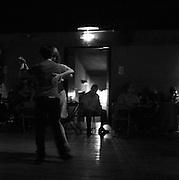 A young couple dance at a San Telmo Milonga.