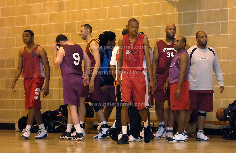 DAGENHAM - MAY 17: Newham Cardinals after a final period time out during the Essex Metropolitan Basketball League Play Off final against Cardinals at Sydney Russell School. Erks won the game 81 - 68.