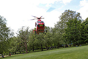 An air ambulance helicopter is seen taking off from Southwark Park in Bermondsey, London after they delivered an NHS emergency medical response unit to a road traffic accident after a motorbike and a car collided in Lower Road intersection with Neptun Street near Canada Water Station on Monday, May 4, 2020. (Photo/ Vudi Xhymshiti)