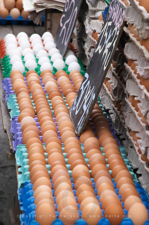 A market stall street market merchant selling white and brown eggs in egg cartons Montevideo, Uruguay, South America