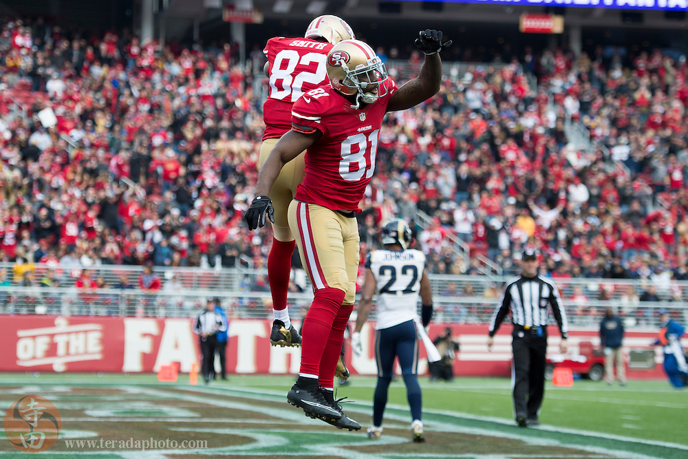 January 3, 2016; Santa Clara, CA, USA; San Francisco 49ers wide receiver Anquan Boldin (81) is congratulated by wide receiver Torrey Smith (82) for scoring a touchdown during the first half against the St. Louis Rams at Levi's Stadium. The 49ers defeated the Rams 19-16.