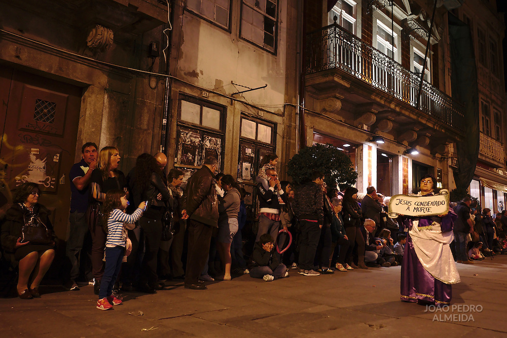 The funebre procession of the Burial of the Lord passing by the streets of Braga