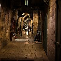 A street scene in the Old City of Jerusalem after dark.