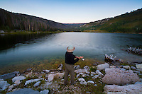 A fisherman casts into a high mountain lake in Utah.