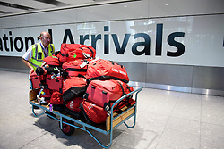 © Licensed to London News Pictures. 23/08/2016. London, UK. Bags belonging to members of the Great Britain Olympic team arrive at terminal 5 of London Heathrow Airport on British Airways flight BA2016. Team GB finished second in the medals table with 67 medals, beating their total of 65 at London 202.  Photo credit: Ben Cawthra/LNP
