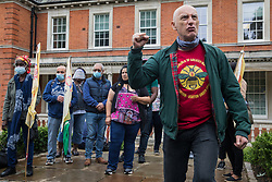Chip Hamer of Poetry on the Picket Line performs for Royal Parks workers outsourced via French multinational VINCI Facilities attending a picket outside the Old Police House in Hyde Park as part of joint strike action by the United Voices of the World (UVW) and Public and Commercial Services (PCS) trade unions on 30th July 2021 in London, United Kingdom. The joint strike, with members dual carding over pay, conditions and the sacking of a member of staff, is believed to be the first between a TUC and a non-TUC trade union and follows the launch of a legal challenge by the Royal Parks workers against indirect racial discrimination by the Royal Parks.