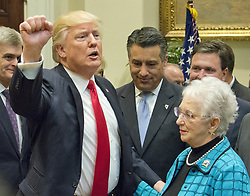 April 26, 2017 - Washington, District of Columbia, U.S.- United States President DONALD J. TRUMP gestures in response to a reporter's question after signing the Education Federalism Executive Order during a federalism event with the nation's Governors in the Roosevelt Room of the White House. The executive order requires the Education Secretary to study whether the federal government has overstepped its legal authority in K-12 schools, a move he framed as part of a broader effort to shift power from Washington to states and local communities. (Credit Image: © Ron Sachs/CNP via ZUMA Wire)