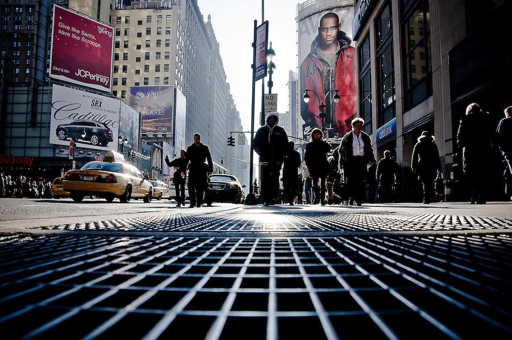 Sidewalk of 7th avenue, at the corner of 34th street in Midtown, Manhattan, New York, 2009.