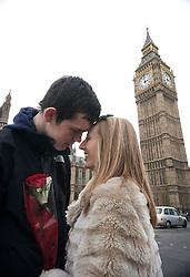 © licensed to London News Pictures. London, UK 14/02/2012. Ben Wood and Harriet Prise enjoying Valentine's Day on Westminster Bridge, London. Photo credit: Tolga Akmen/LNP