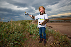 Alve Royle (5) taking part as SSE Renewables do a the beach clean in Carnoustie on Saturday morning.