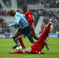 Photo. Andrew Unwin, Digitalsport.<br /> NORWAY ONLY<br /> <br /> Middlesbrough v Manchester City, Barclaycard Premier League, Riverside Stadium, Middlesbrough 08/05/2004.<br /> Middlesbrough's Gaizka Mendieta (r) slides in to dispossess Manchester City's Nicolas Anelka (l).