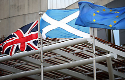 File photo dated 13/03/17 of a Union Jack, Saltire and European flag fly outside the Scottish Parliament, Edinburgh. Almost half of Scots would back an independent Scotland in the European Union (EU) if a second referendum was held in early 2019, a new poll suggests.