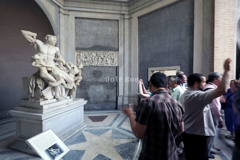 tourists with historical sculpture Laecoon Vatican museum Rome