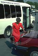female, African American, car, airport shuttle bus