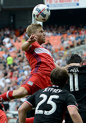 May 20, 2017 - Washington, DC, USA - 20170520 - Chicago Fire midfielder BASTIAN SCHWEINSTEIGER (31) attempts to head a shot on goal over D.C. United forward SEBASTIEN LE TOUX (11) and D.C. United midfielder JARED JEFFREY (25) in the first half at RFK Stadium in Washington. (Credit Image: © Chuck Myers via ZUMA Wire)