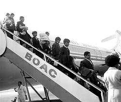 File photo dated 23/09/72, ref 158703-1 of Asian families arriving in Britain from Entebbe, Uganda.  A thanksgiving service at Westminster Abbey today (Thursday) marks the arrival of nearly 30,000 Ugandan Asians in Britain 25 years after the Ugandan President Idi Amin ordered all Ugandan Asians to leave the country within three months.  See PA Story SOCIAL Uganda.  Photo PA available in black and white only.