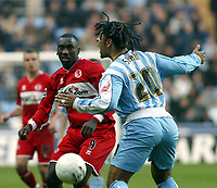Photo: Chris Ratcliffe.<br />Coventry City v Middlesbrough. The FA Cup. 28/01/2006.<br />Jimmy Floyd Hasselbaink (L) of Boro and Richard Shaw of Coventry tussle for the ball.