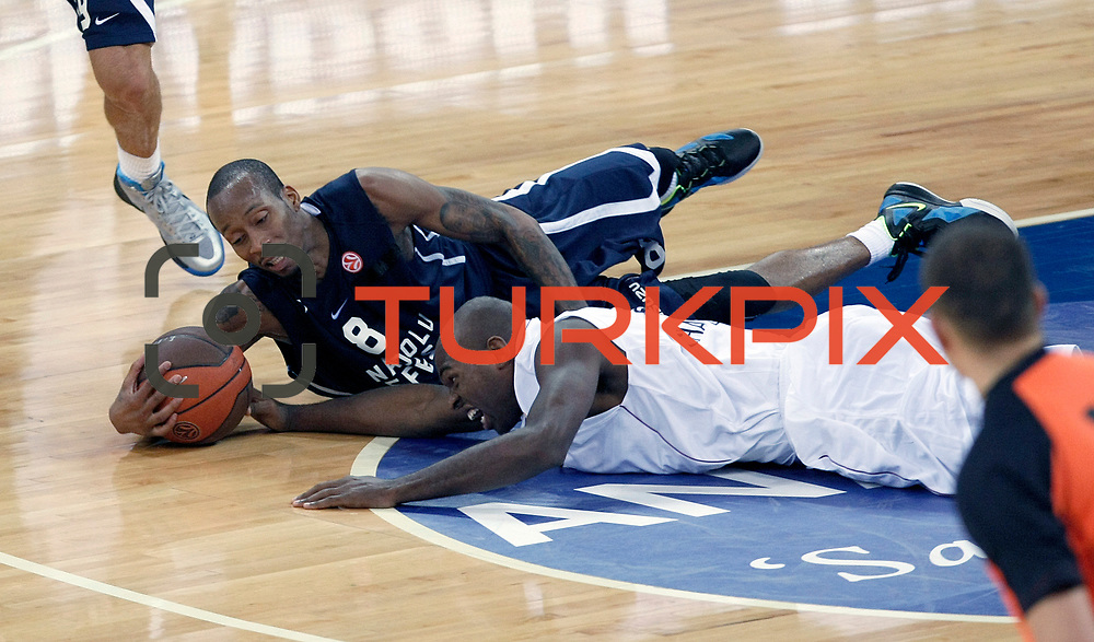 Anadolu Efes's Terence KINSEY (L) during their Turkish Airlines Euroleague Basketball Group C Game 2 match Anadolu Efes between Belgacom Spirou  at Abdi Ipekci Arena in Istanbul, Turkey, Wednesday, October 26, 2011. Photo by TURKPIX