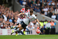 Mame Biram Diouf of Stoke City fouls Ben Davies of Tottenham Hotspur.  Barclays Premier league match, Tottenham Hotspur v Stoke city at White Hart Lane in London on Saturday 15th August 2015.<br /> pic by John Patrick Fletcher, Andrew Orchard sports photography.