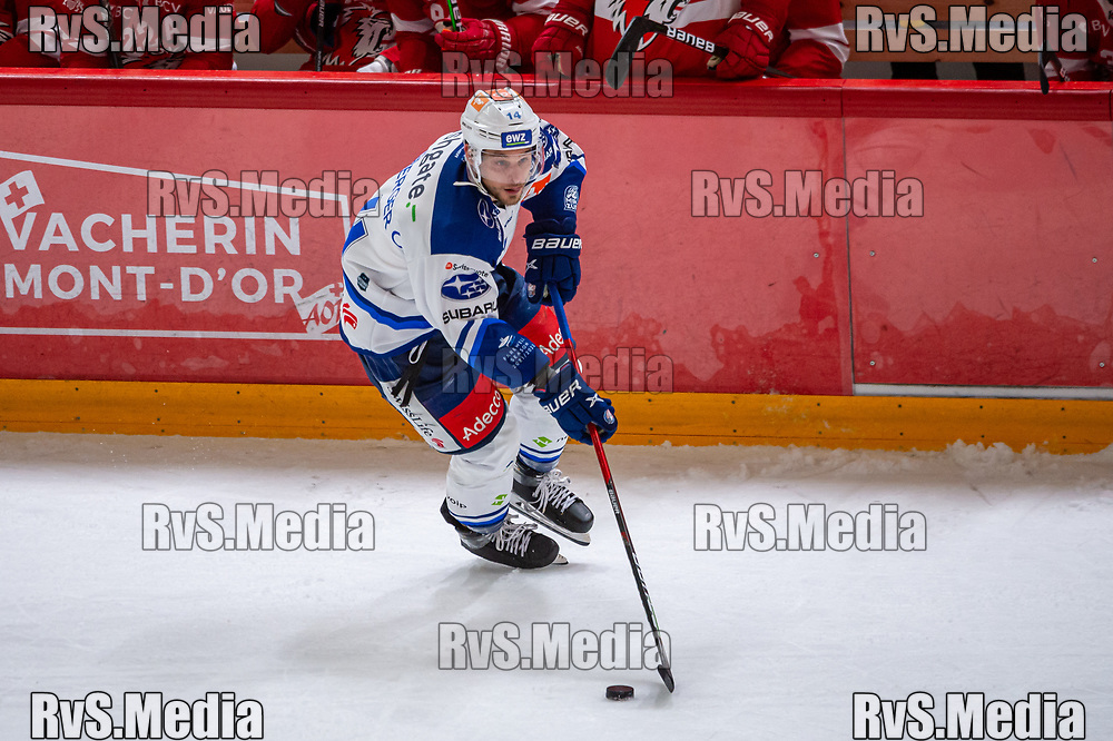 LAUSANNE, SWITZERLAND - OCTOBER 01: Chris Baltisberger #14 of ZSC Lions in action during the Swiss National League game between Lausanne HC and ZSC Lions at Vaudoise Arena on October 1, 2021 in Lausanne, Switzerland. (Photo by Robert Hradil/RvS.Media)