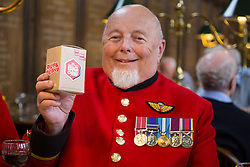 © licensed to London News Pictures. London, UK 02/10/2012. Wayne Campbell, 75, a Chelsea Pensioner holding a Big Curry tip box as Chelsea Pensioners launch The Soldiers' Charity Big Curry season with a special a curry lunch at Royal Hospital Chelsea's Royal Hall in London on 02/10/12. Photo credit: Tolga Akmen/LNP