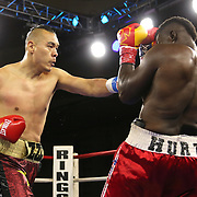 Zhilei Zhang of Zhoukou, China (L) punches Curtis Harper of Jacksonville, Florida during a Nelsons Promotions boxing match at the Boca Raton Resort  and Club on Friday, May 26, 2017 in Boca Raton, Florida.  (Alex Menendez via AP)