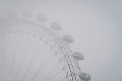 © Licensed to London News Pictures. 03/03/2018. London, UK. Mist shrouds the London Eye in Westminster on another freezing morning in the capital. Large parts of the UK are recovering from a week of sub zero temperatures and heavy snowfall, following two severe cold fronts. Photo credit: Ben Cawthra/LNP