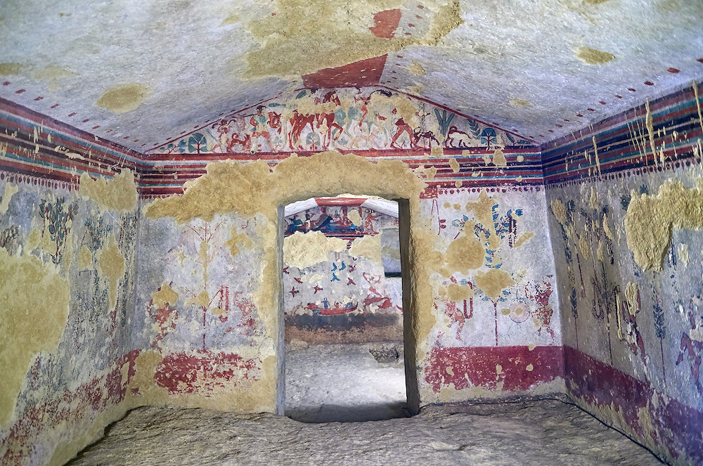 """Underground Etruscan tomb Known as """"Tomba della Caccia e della Pesca"""". A double chamber with double sloping ceiling. In the tsecond chamber can be see a scene of hunting and fishing in the style of the """"little Ionic masters"""" . 520-510 BC. Excavated 1873 , Etruscan Necropolis of Monterozzi, Monte del Calvario, Tarquinia, Italy. A UNESCO World Heritage Site. .<br /> <br /> Visit our ETRUSCAN PHOTO COLLECTIONS for more photos to buy as buy as wall art prints https://funkystock.photoshelter.com/gallery-collection/Pictures-Images-of-Etruscan-Historic-Sites-Art-Artefacts-Antiquities/C0000GgxRXWVMLyc"""