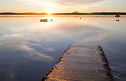 Boats at moorings at sunset on the River Deben, Ramsholt, Suffolk, England