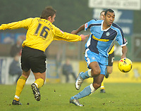 Photo: Alan Crowhurst.<br />Wycombe Wanderers v Rochdale. Coca Cola League 2.<br />10/12/2005. <br />Kevin Betsy (R) attacks for Wycombe.