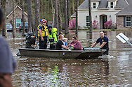 Covington Louisiana, March, 12, 2016,<br /> Rescue crew evacuates residents in the Tallow Creek subdivision to safety. 14 inches of rain fell in less than 24 hours, after three days of intermittent rain, causing flash floods. The Tchefuncte River  and Bogue Falaya River<br />  crested on Saturday morning but the flood event continued into the night for those in Tallow Creek.
