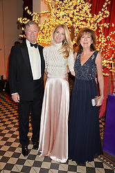 Left to right, the 5th EARL OF BALFOUR, his daughter LADY JUBIE WIGAN and the COUNTESS OF BALFOUR at the Sugarplum Dinner - The event was for the launch of Sugarplum Children, a new website and fundraising initiative for children who live with type 1 diabetes, and to raise money for JDRF (Juvenile Diabetes Research Foundation) held at One Mayfair, 13A North Audley Street, London on 20th November 2013.
