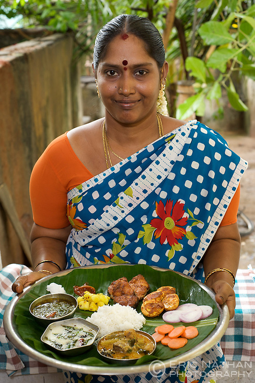 Indian lady with a thali (traditional food platter) in Pondicherry, India.