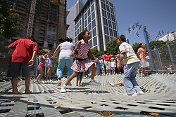 Stock photo of children bouncing on the trampoline at the playground