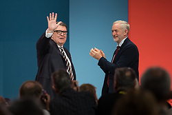 © Licensed to London News Pictures . 30/09/2015 . Brighton , UK . TOM WATSON waves to the crowd and is applauded by JEREMY CORBYN after Watson delivered his speech as Deputy Leader of the Labour Party . The 2015 Labour Party Conference . Photo credit : Joel Goodman/LNP