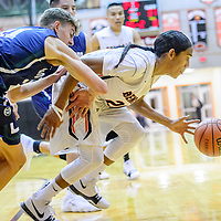 Gallup Bengal Quincy Smith (20) dribbles  away from the  Rio Rancho Ram basket at Gallup High School Tuesday.