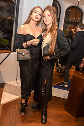 Left to right, Xenia Tchoumi and Liza Urla at a party hosted by Nicholas Kirkwood and Eva Fehren to celebrate Part 2 in the Nicholas Kirkwood presents series held at Nicholas Kirkwood, 5 Mount Street, London England. Eva Fehren is a fine jeweller, born and raised in New York City. Her collections are both inspired and created in the city, and via the Nicholas Kirkwood store, it is the first opportunity to view and shop the collection in London. 9 November 2017.
