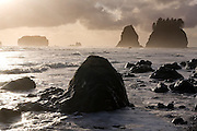 Large rocks at sunset with sea stacks in the background, Second Beach, Olympic National Park, Washington.