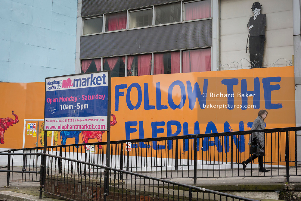 Hoardings and the figure of Charlie Chaplin - a former Walworth resident - at Elephant and Castle shopping centre, on 29th March, 2018 in London, England.