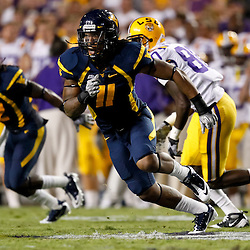 Sep 25, 2010; Baton Rouge, LA, USA; West Virginia Mountaineers cornerback Sidney Glover (11) pursues a play against the LSU Tigers during the second half at Tiger Stadium. LSU defeated West Virginia 20-14.  Mandatory Credit: Derick E. Hingle