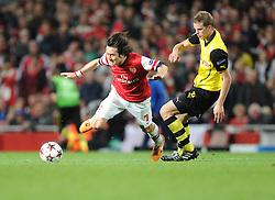 Borrusia Dortmund's Ilkay Gundogan fouls Arsenal's Tomas Rosicky - Photo mandatory by-line: Alex James/JMP - Tel: Mobile: 07966 386802 22/10/2013 - SPORT - FOOTBALL - Emirates Stadium - London - Arsenal v Borussia Dortmund - CHAMPIONS LEAGUE - GROUP F