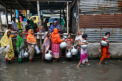 June 17, 2017 - Dhaka, Bangladesh - Bangladeshi women and kids are busy to collecting drinking water from a polluted water logged area in Dhaka on June 17, 2017. (Credit Image: © Mehedi Hasan/NurPhoto via ZUMA Press)